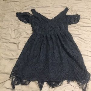 Women's navy blue lace skater dress.